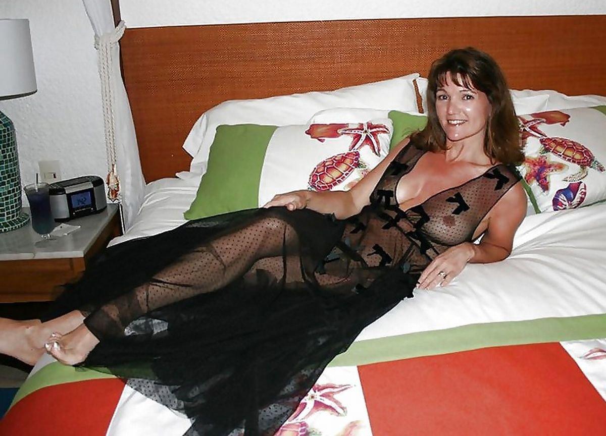 Mature Woman Bed Stock Photos