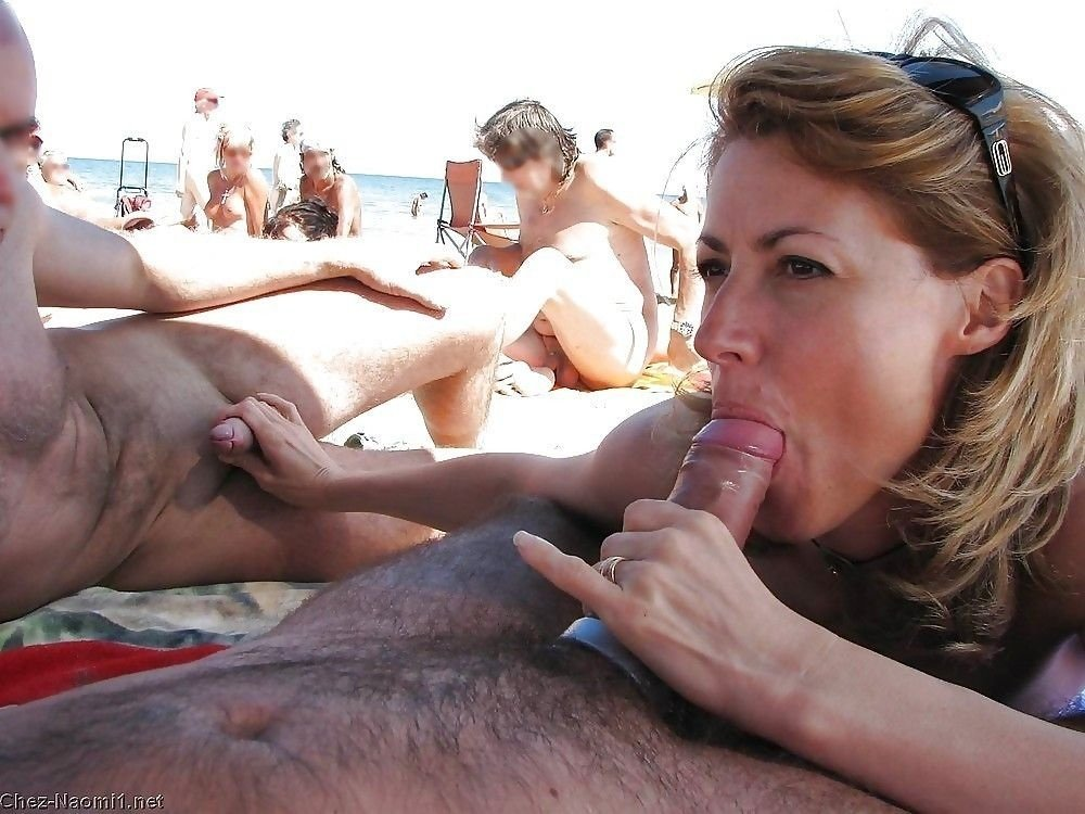 Hot blonde whore sucking cock on the beach