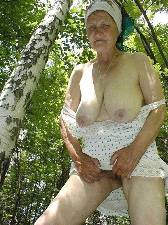 Sexy blonde granny outdoor near car photos