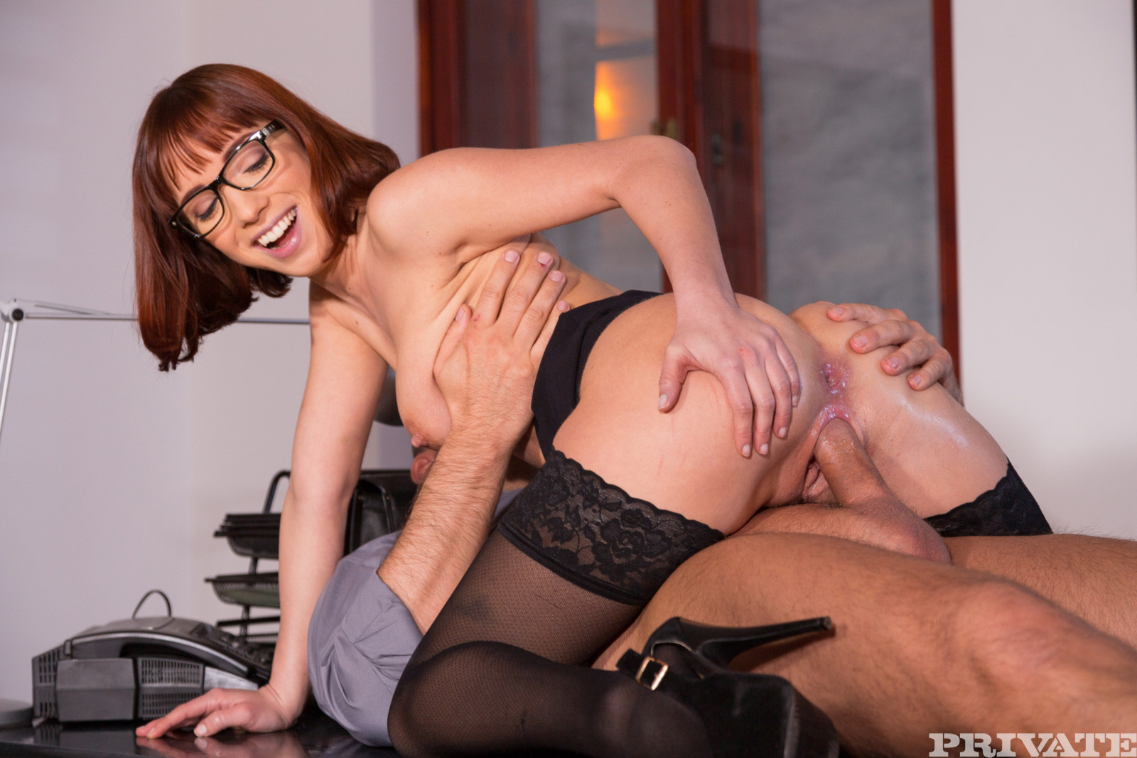 Secretary Wearing Stockings And A Garter Belt Getting Fucked On A Couch