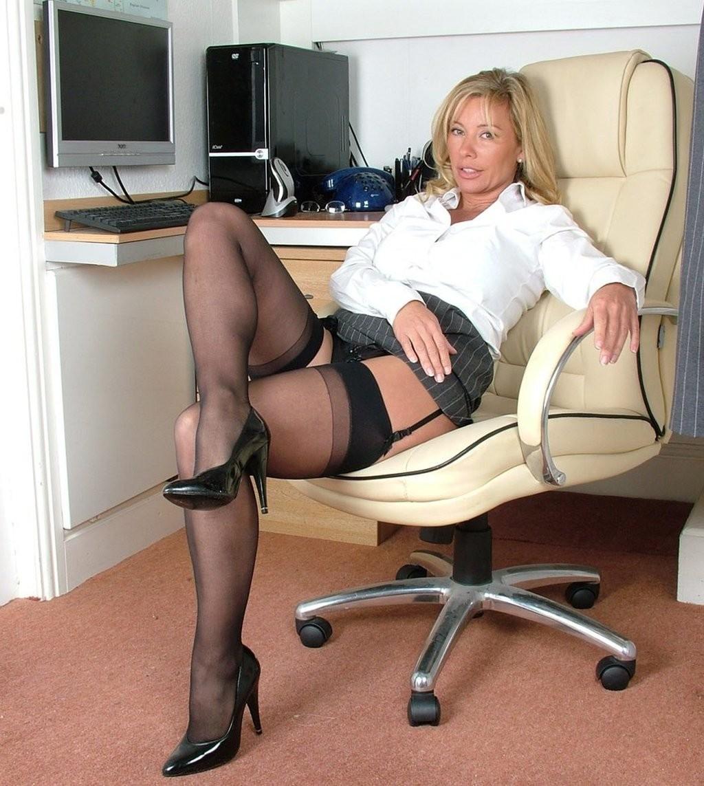 Mature secretary in stocking